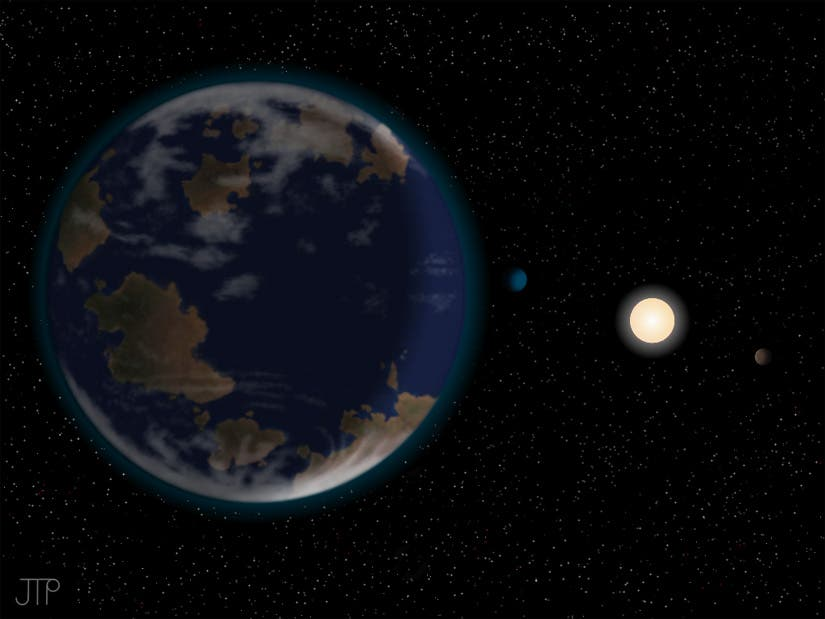 Artist impression of HD40307g in the foreground, with its host star HD40307 and two other planets in the system. (c) NASA