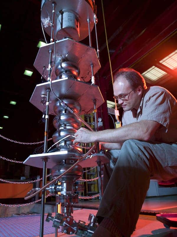 Scientists prepare a superconducting cavity for a test in Fermilab's Vertical Test Stand. (Courtesy Fermilab Visual Media Services)