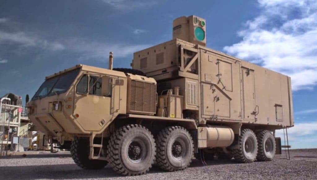 The world's most powerful laser weapon -- blasts a car from a mile away!