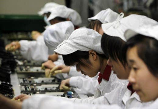 A 2010 photo shows assembly line workers at a Foxconn plant in Shenzhen, a city in southern China. Shifts are 12 hours, with two breaks for meals at a company cafeteria. Robots don't have to eat though or take a break. Hence robots are better.