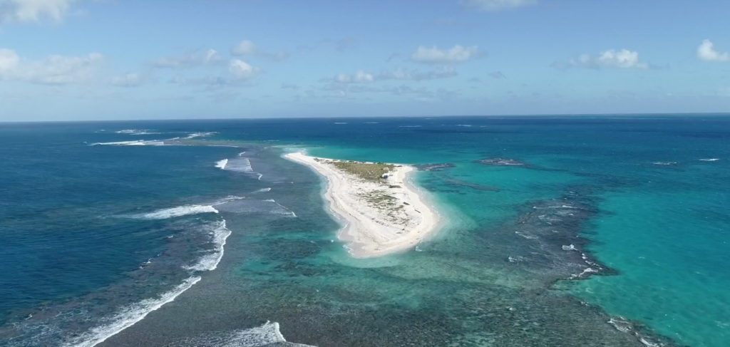 East Island looking serene and welcoming. A cat-3 hurricane destroyed most of it. Credit: YouTube.