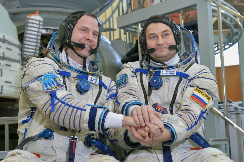 At the Gagarin Cosmonaut Training Center in Star City, Russia, Expedition 55 backup crew members Nick Hague of NASA (left) and Alexey Ovchinin of Roscosmos (right) pose for pictures during a day of qualification exams Feb. 20, 2018. Credit: Wikimedia Commons.