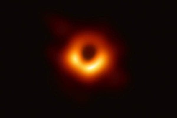 Picture showing a black hole's shadow found at the centre of galaxy M87. Credit: EHT Collaboration. EHT Collaboration